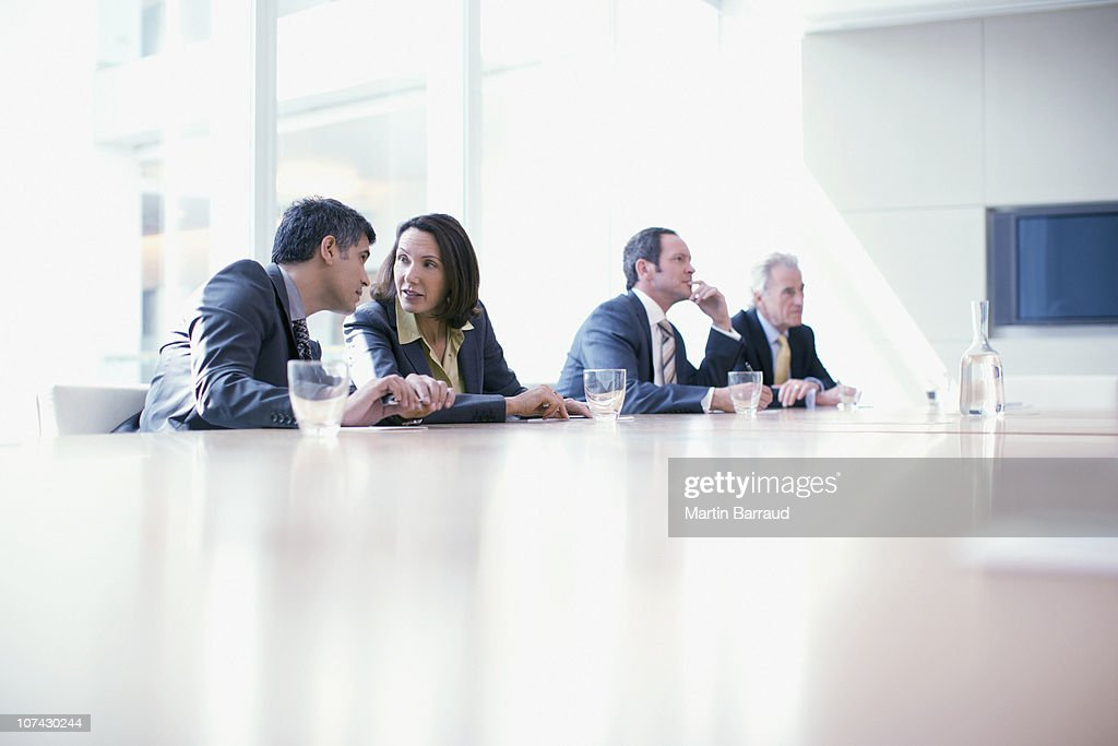 Business people sitting in conference room talking : Stock Photo