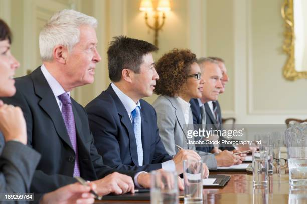 business people sitting in meeting - politician stock pictures, royalty-free photos & images