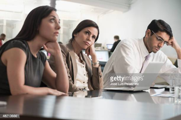business people sitting in meeting - boredom stock pictures, royalty-free photos & images