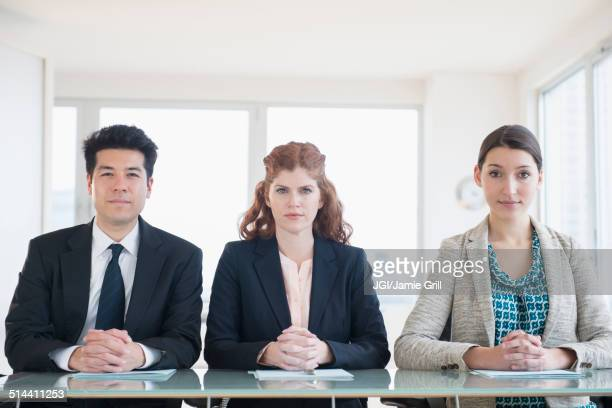 business people sitting in meeting - aggression stock pictures, royalty-free photos & images