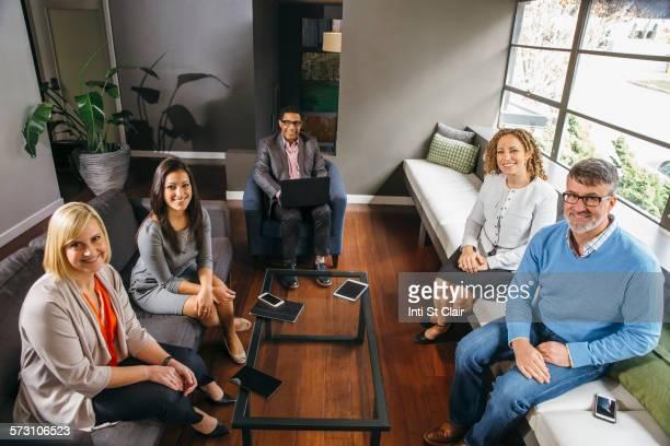 business people sitting in office meeting - cinq personnes photos et images de collection