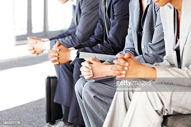 Business People Sitting Nervously