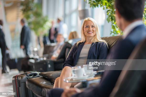 business people sitting on chair at airport - 45 49 years stock pictures, royalty-free photos & images
