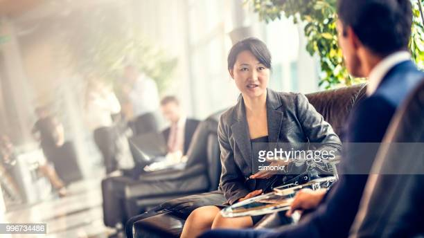 business people sitting on chair at airport - businesswear stock pictures, royalty-free photos & images
