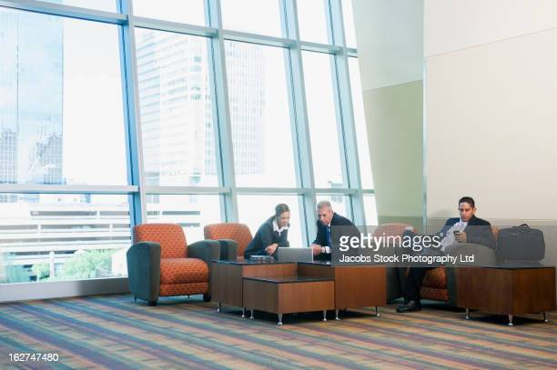 Business people sitting together in waiting area