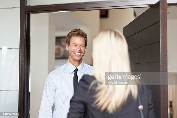 Business people smiling at each other