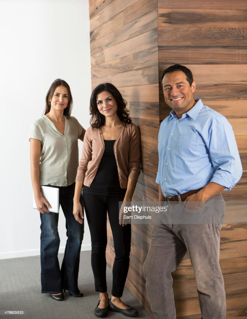 Business people smiling in office : Stock Photo