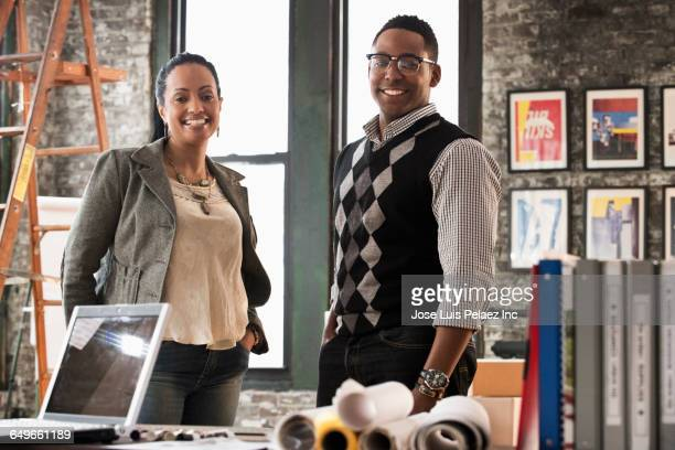 business people smiling in office - sweater vest stock photos and pictures