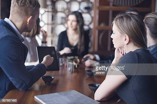 Business people socializing in restaurant