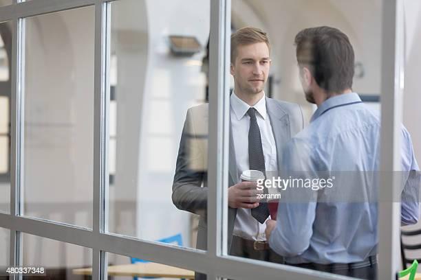 Business people socializing on a coffee break