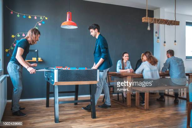 Business people spending leisure time in cafeteria