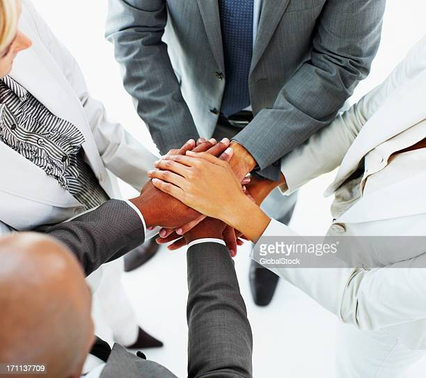 Business people stacking their hands