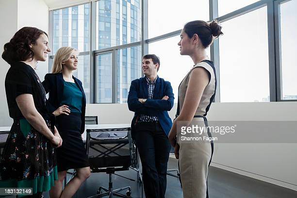 Business people standing and having a meeting