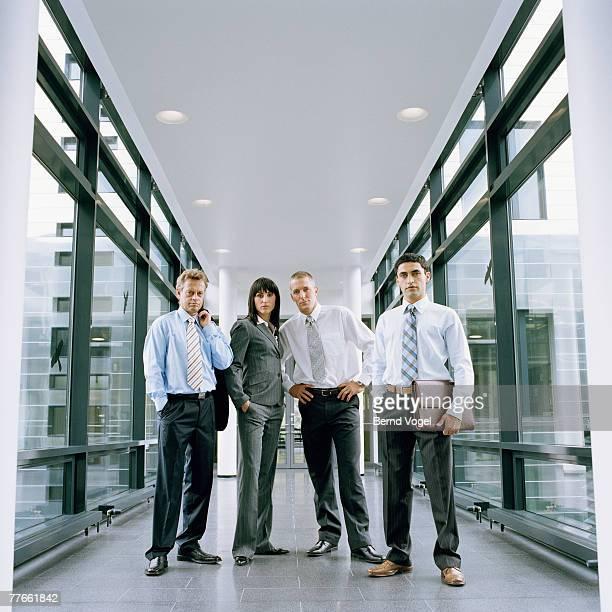 Business people standing in corridor of office