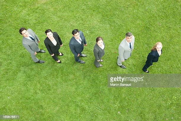 Business people standing in line outdoors