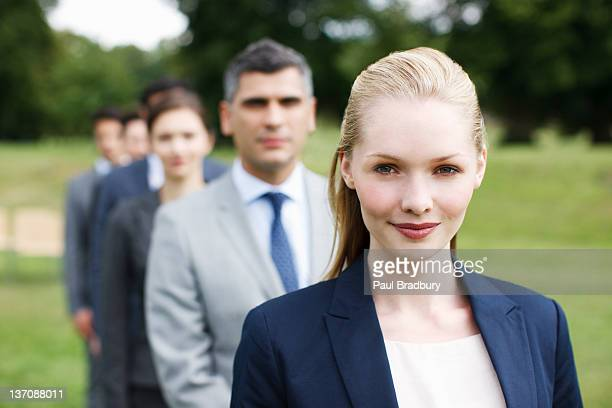 Business people standing in line together outdoors