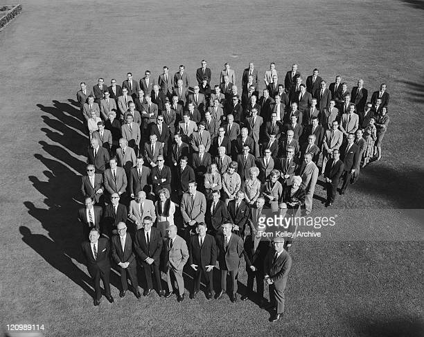 Business people standing in meadow