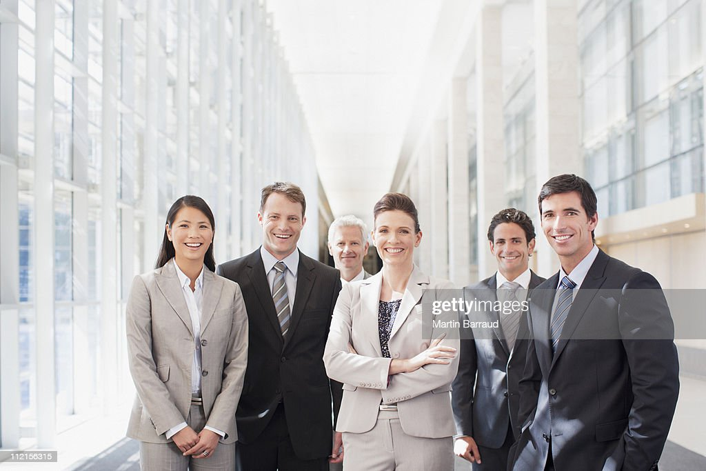 Business people standing in office : Stock Photo