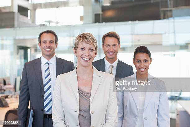 Business people standing in office together
