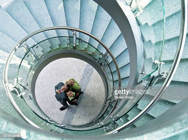 Business people standing in stairwell