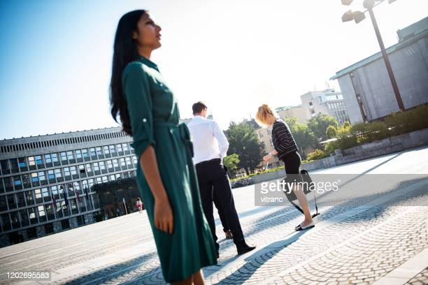 business people standing in street and discussing - businesswear stock pictures, royalty-free photos & images