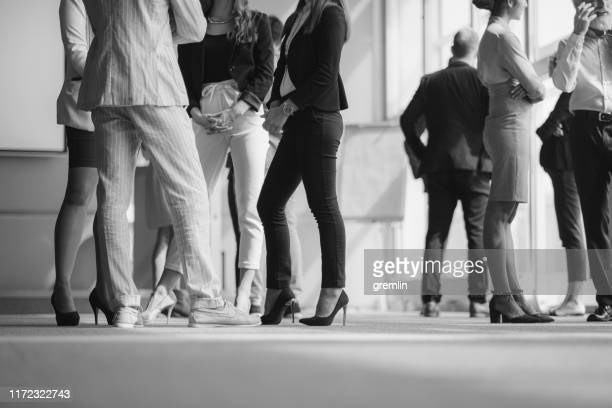 business people standing in the conference room - clique stock pictures, royalty-free photos & images