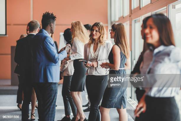 business people standing in the conference room - event stock pictures, royalty-free photos & images