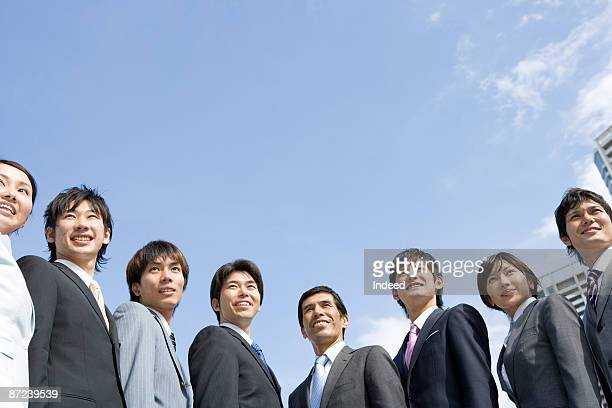 Business people standing, low angle view