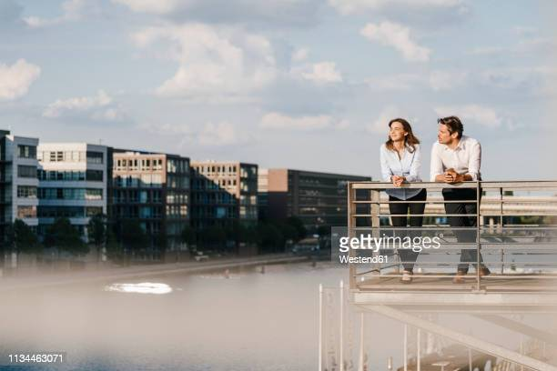 business people standing on balcony - balcony stock pictures, royalty-free photos & images