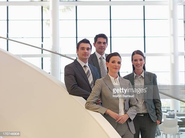 Business people standing on staircase