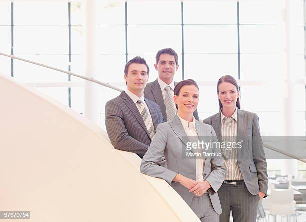 Business people standing on stairs