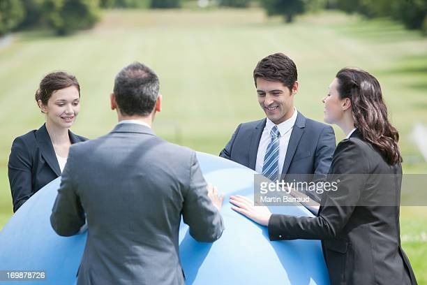 business people standing outdoors with large ball - man with big balls stock photos and pictures