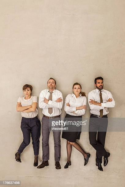 Business people standing side by side with arms crossed