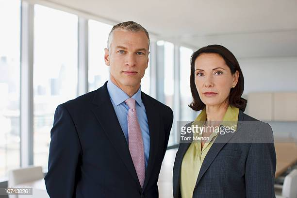 business people standing together in conference room - full suit stock pictures, royalty-free photos & images