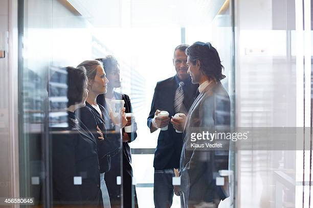 Business people standing together in elevator