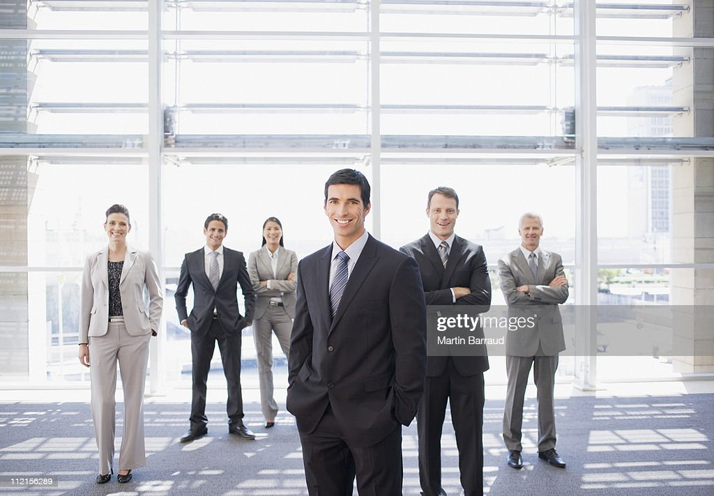 Business people standing together in office : Stock Photo