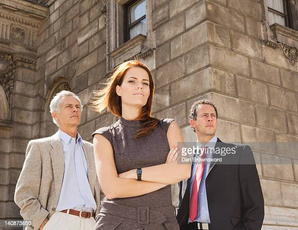 business people standing together - waist up stock pictures, royalty-free photos & images