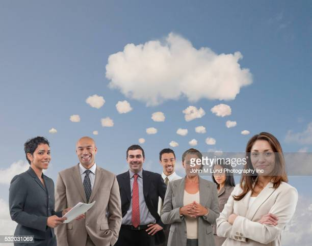 business people standing under communal thought bubble - thought bubble stock pictures, royalty-free photos & images