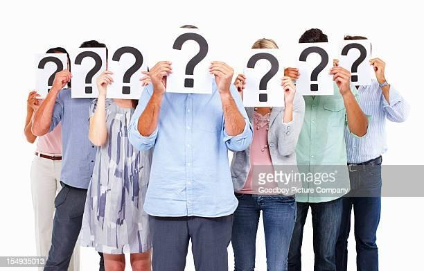 ビジネスの人々に立つ疑問符オンボード