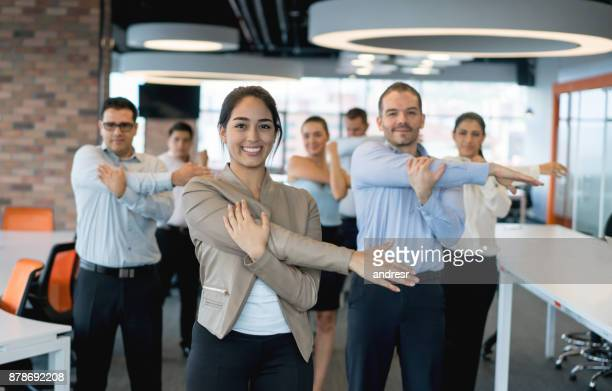 Business people stretching at the office