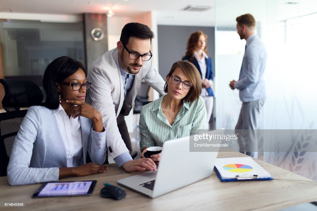 Business people studying statistic report using laptop : Stock Photo