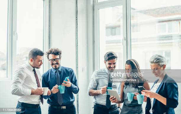 business people taking a break at work - work romance stock pictures, royalty-free photos & images