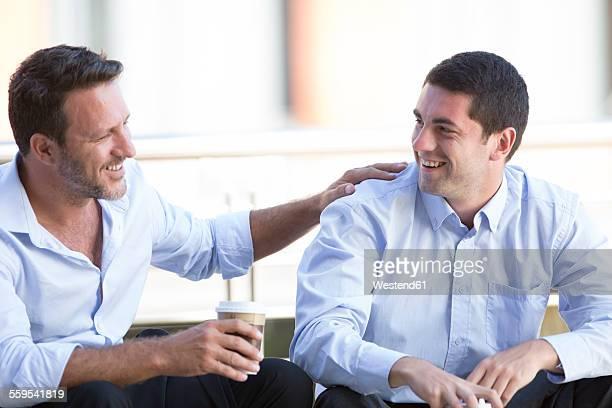 Business people taking a break, drinking coffee