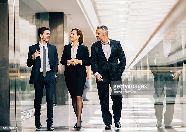 business people taking a break - three people stock pictures, royalty-free photos & images