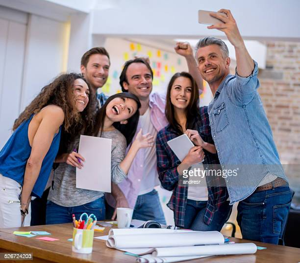 Business people taking a selfie