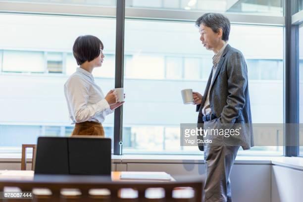 Business people taking coffee break time