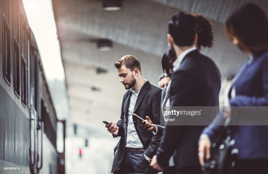 Business People Taking Public Transportation : Stock Photo