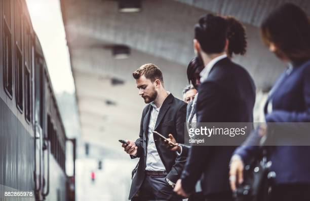business people taking public transportation - rush hour stock pictures, royalty-free photos & images