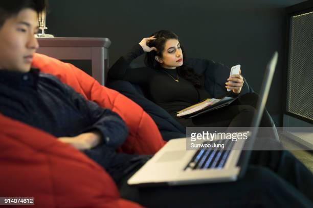 Business people taking rest in modern space
