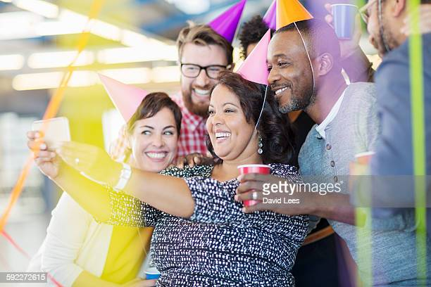 Business people taking selfie at office party